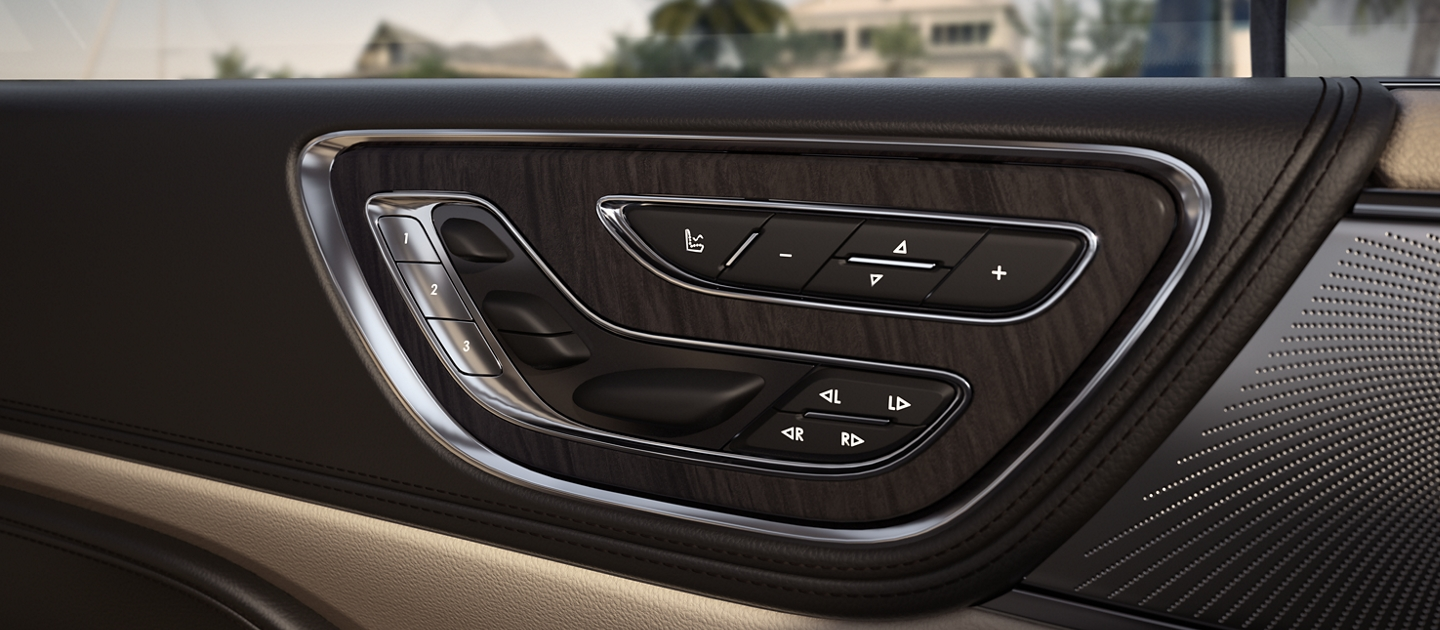 The available Perfect Position Seat controls are seen mounted in the front doors