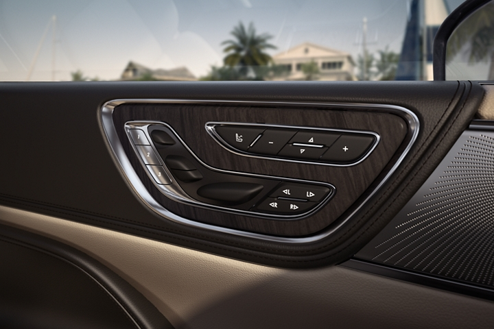 The available Perfect Position Seat controls are shown mounted within the front drivers door for ease of use