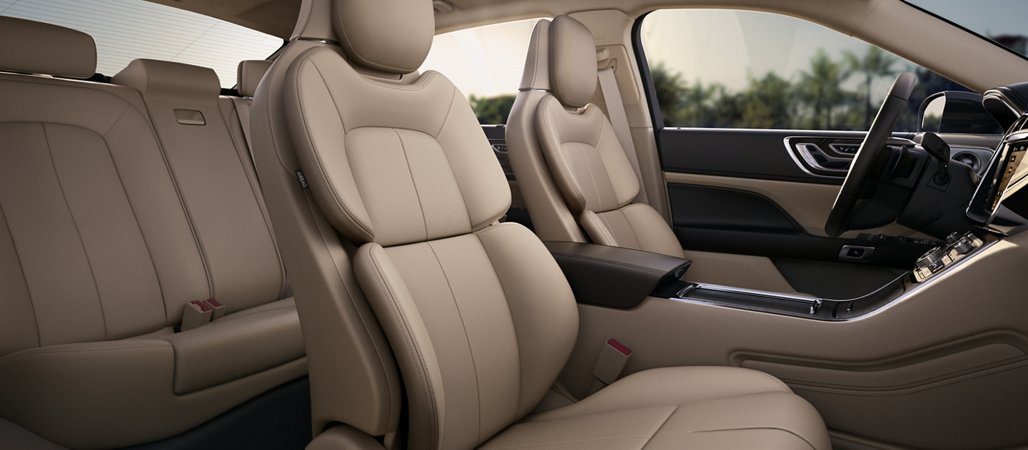 The available Perfect Position Seats with Active Motion are shown in the Cappuccino interior color