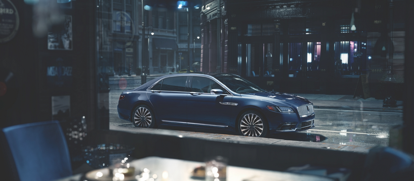2020 Black Label Lincoln Continental seen through a restaurant window