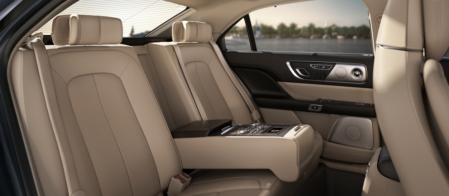 A rear seat view of the 2020 Lincoln Continental featuring an available Rear Seat Amenities Package