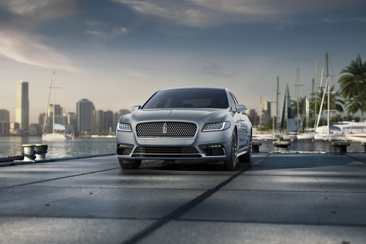 A 2020 Lincoln Black Label Continental in the Chroma Crystal Blue exterior color is shown parked on a pier