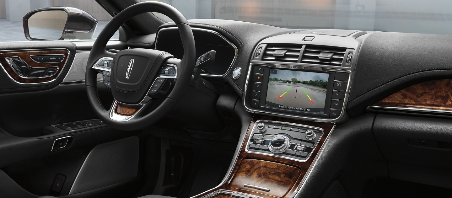 The center console screen is shown displaying a clear driveway behind a 2020 Lincoln Continental