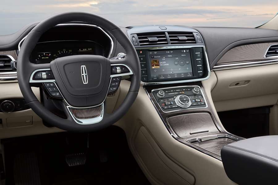 The TIDAL interface is shown in the center touch screen giving you access to a wide selection of music and entertainment