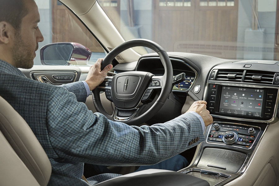 The SYNC three interface is displayed on the center touch screen within a Lincoln Continental
