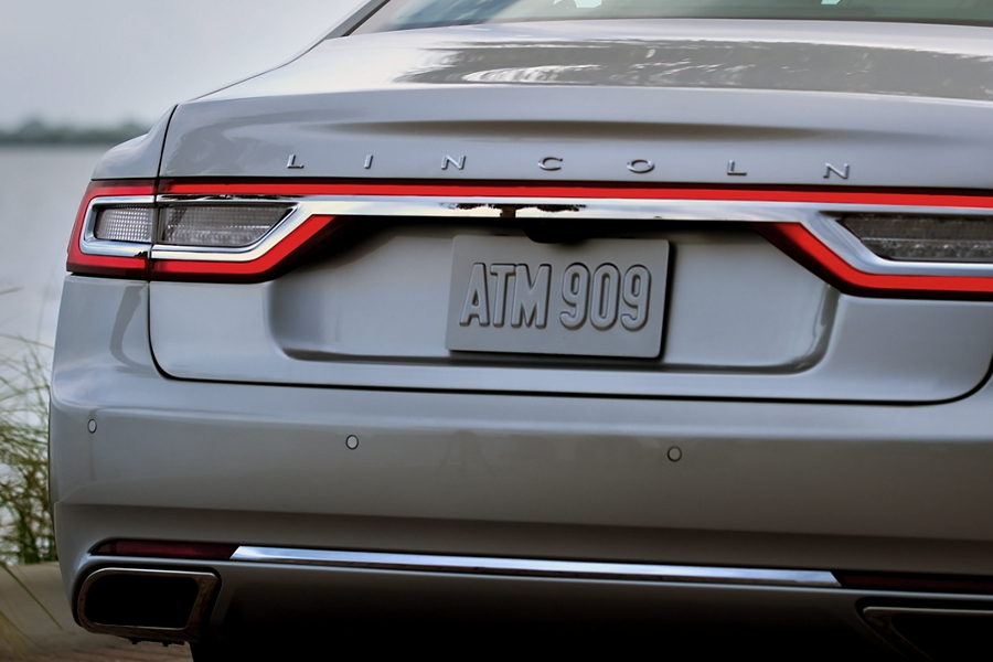The Trunk of a 2020 Lincoln Continental is shown just before a person approaches to trigger the hands