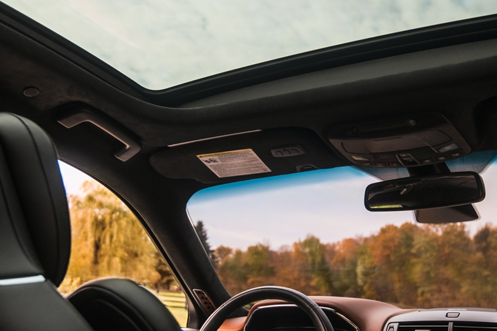 The dual panel moon roof of a 2020 Lincoln Continental is shown from the rear seat