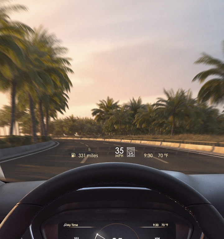 The available head up display is shown projecting vehicle speed limit and other important information onto the windshield