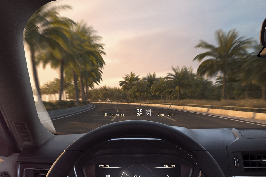 The Head Up Display is shown projecting vehicle speed limit and other vital information on the inside of the windshield