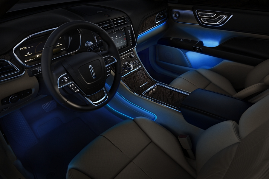 Interior ambient lighting softly glows from multiple points throughout the cabin