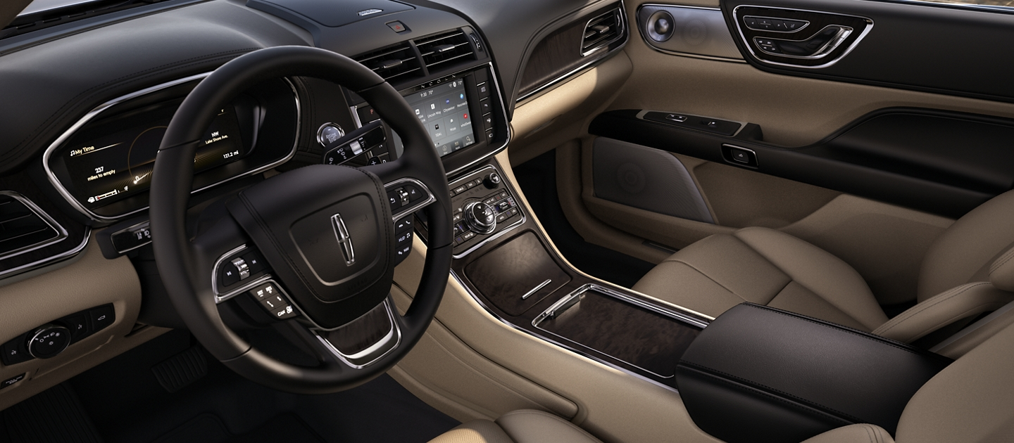 The front seats seen in the Cappuccino interior color display craftsmanship and a connected flow
