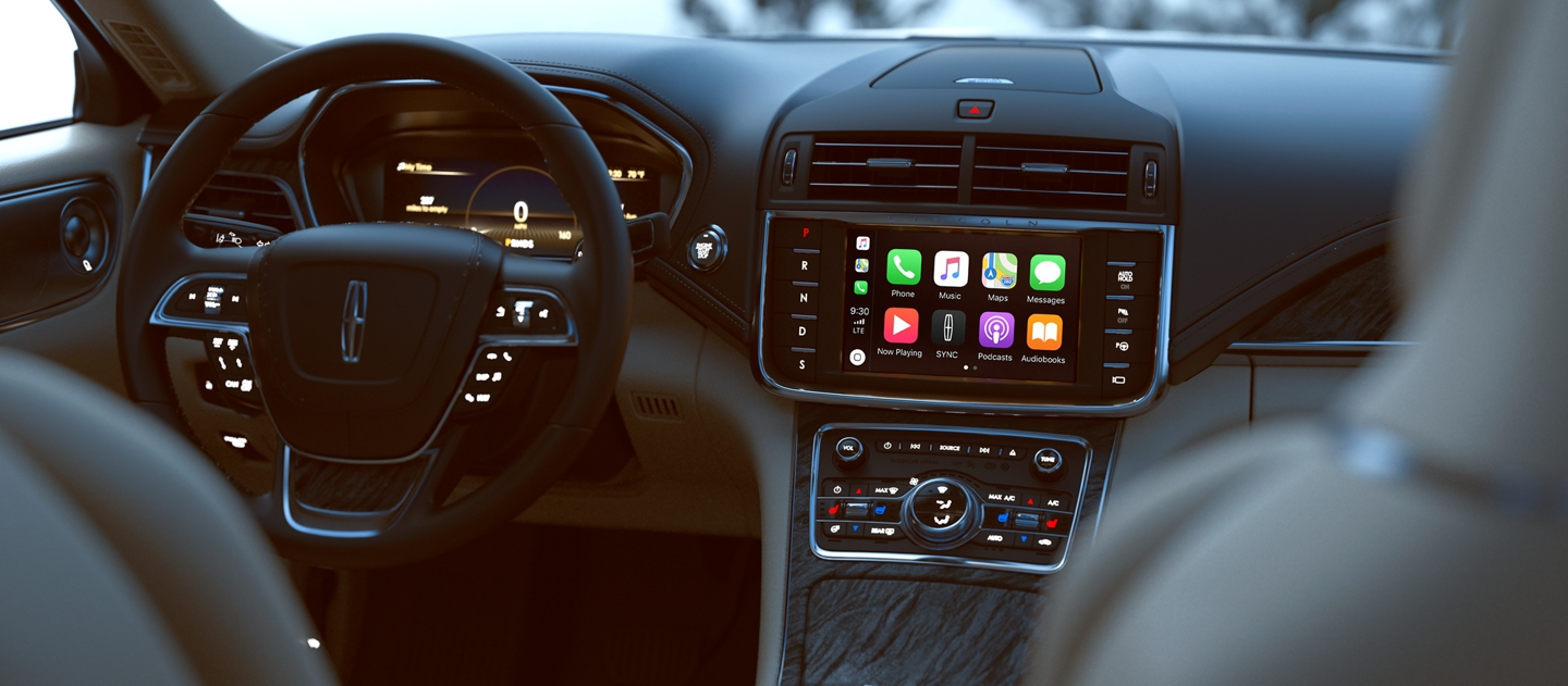 The Apple Car play interface shown in the center touch screen of a 2020 Lincoln Continental allows you to connect with your iPhone