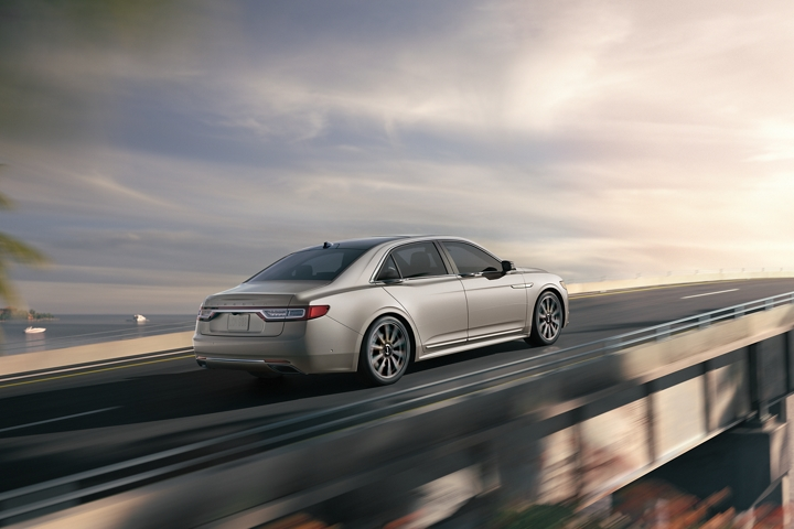 A 2020 Lincoln Continental is shown being driven across an elevated bridge to demonstrate the power of twin turbocharging