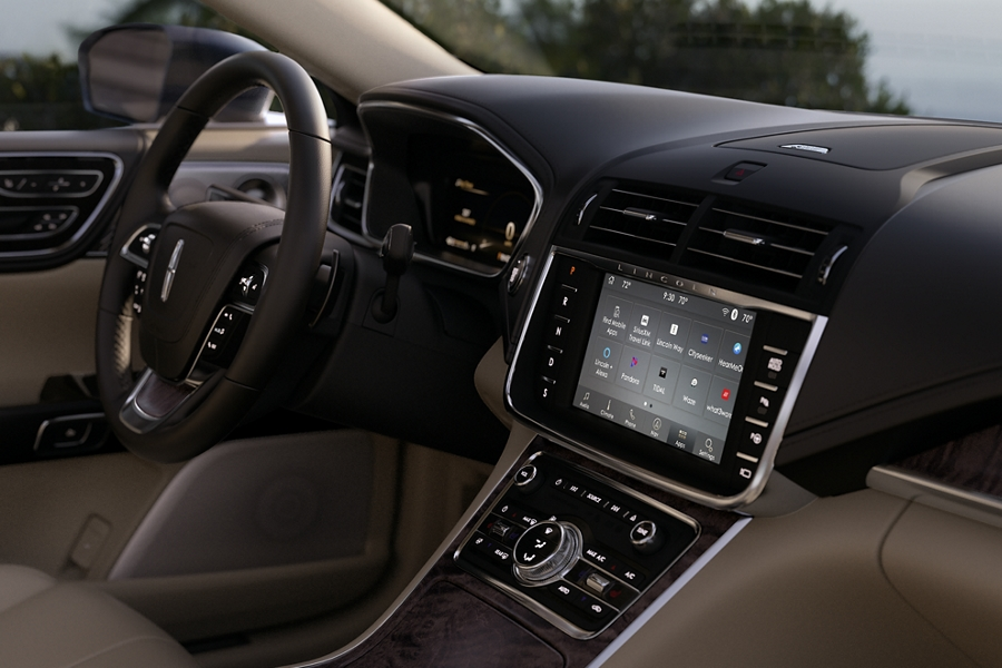 The dashboard and center console are shown to highlight how the interior offers a virtually seamless
