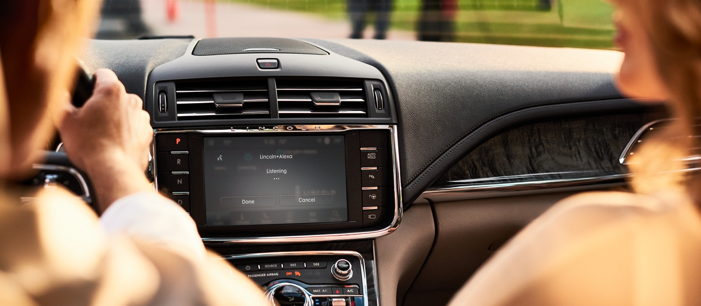 The Lincoln Plus Alexa app interface is shown in the center touch screen of a 2020 Lincoln Continental
