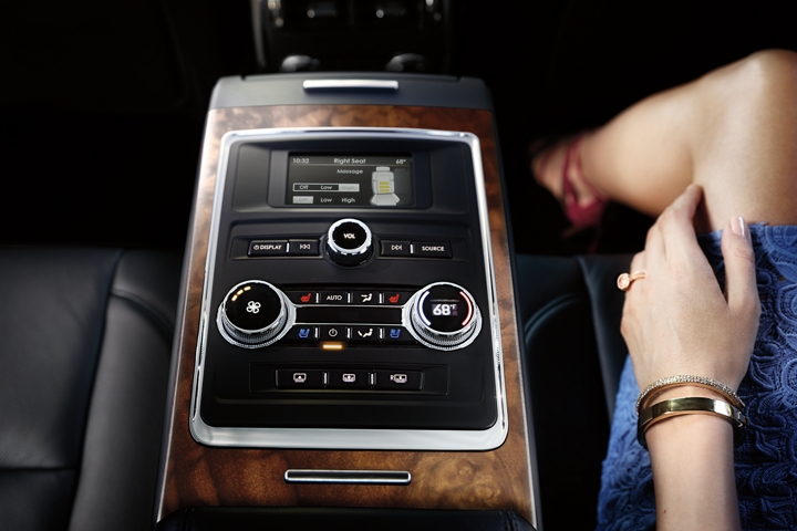 The control system of the available rear seat amenities package is shown in the foldable arm rest in the rear seat