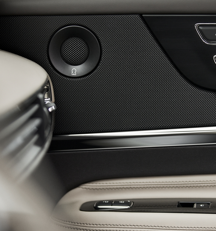 A black revel door speakers contrasting texture mimics the goosebump raising sensation of the sound system