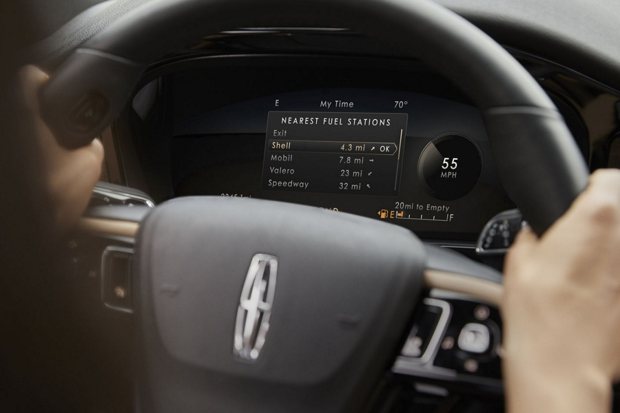 A friendly considerate prompt alert is displayed in the digital cluster behind the steering wheel inside a 2020 Lincoln Corsair