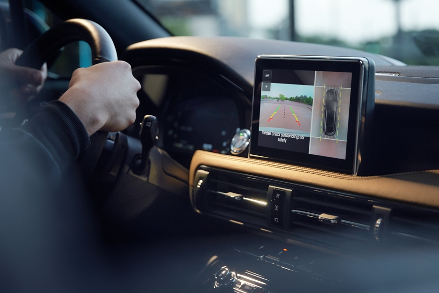 The center stack shows a split screen view of the three sixty degree camera display feature with a birds eye view of the vehicle and surroundings