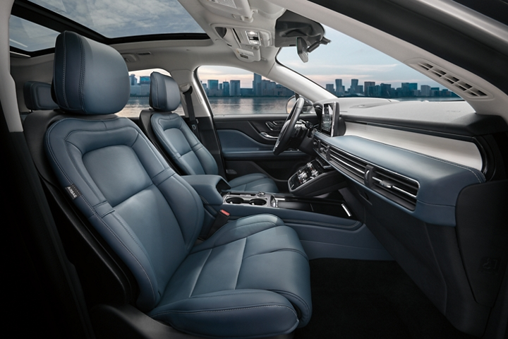 The Beyond Blue interior of a 2020 Lincoln Corsair shows a color palette of deep blue and black materials with white stitching and floating chrome