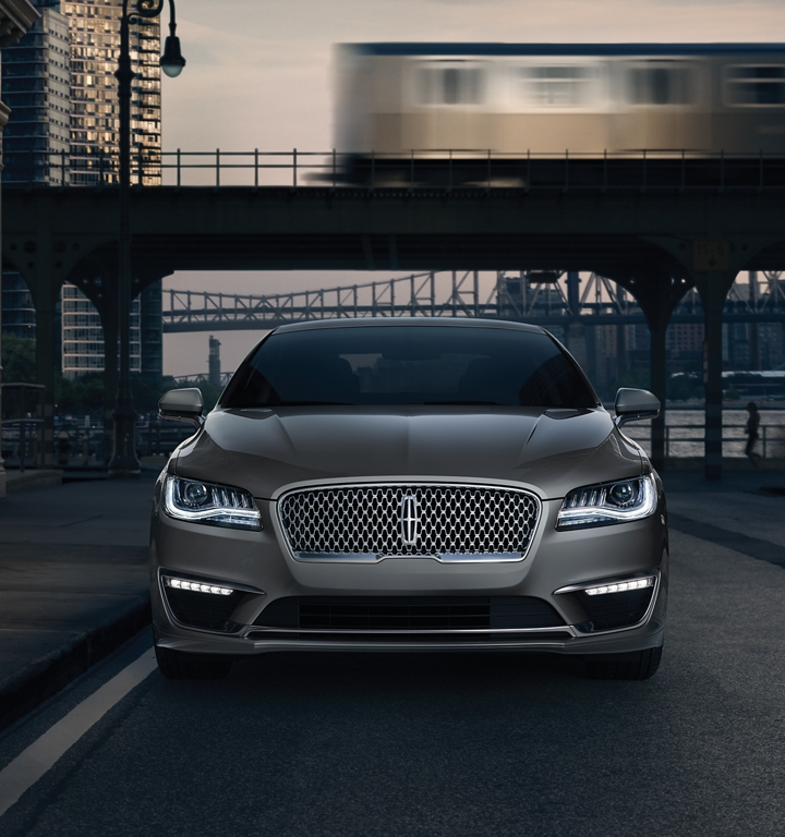 A 2020 Lincoln M K Z is shown parked in a city setting while an elevated train whizzes by in the background