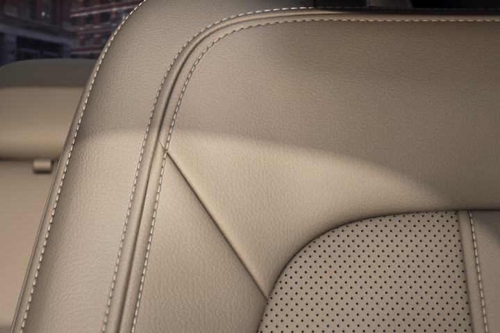 The interior of the 2020 Lincoln M K Z shown with perforated Cappuccino leather and fine stitching