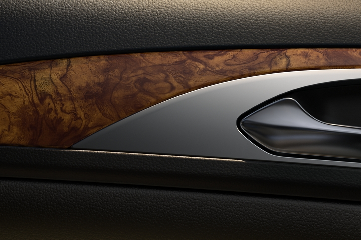 Close up image of woodgrain shown near the passenger side front door