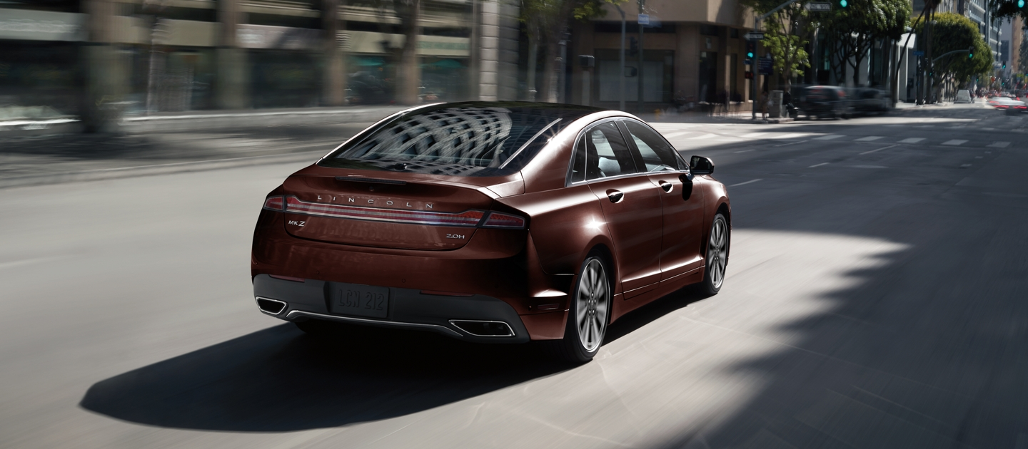 A 2020 Lincoln M K Z is shown being driven on a city street