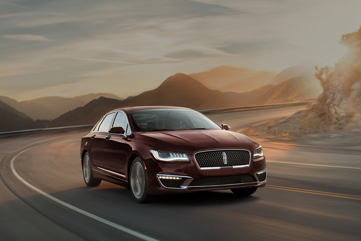 A 2020 Lincoln M K Z is shown being driven on a sharp mountain turn