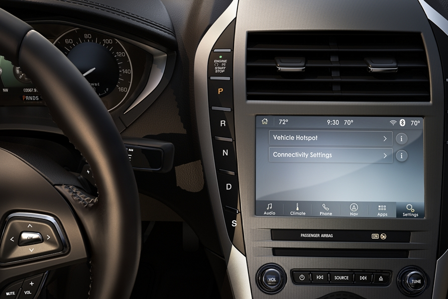 The center console of a 2020 Lincoln M K Z is shown to help demonstrate why fie connectivity within the vehicle