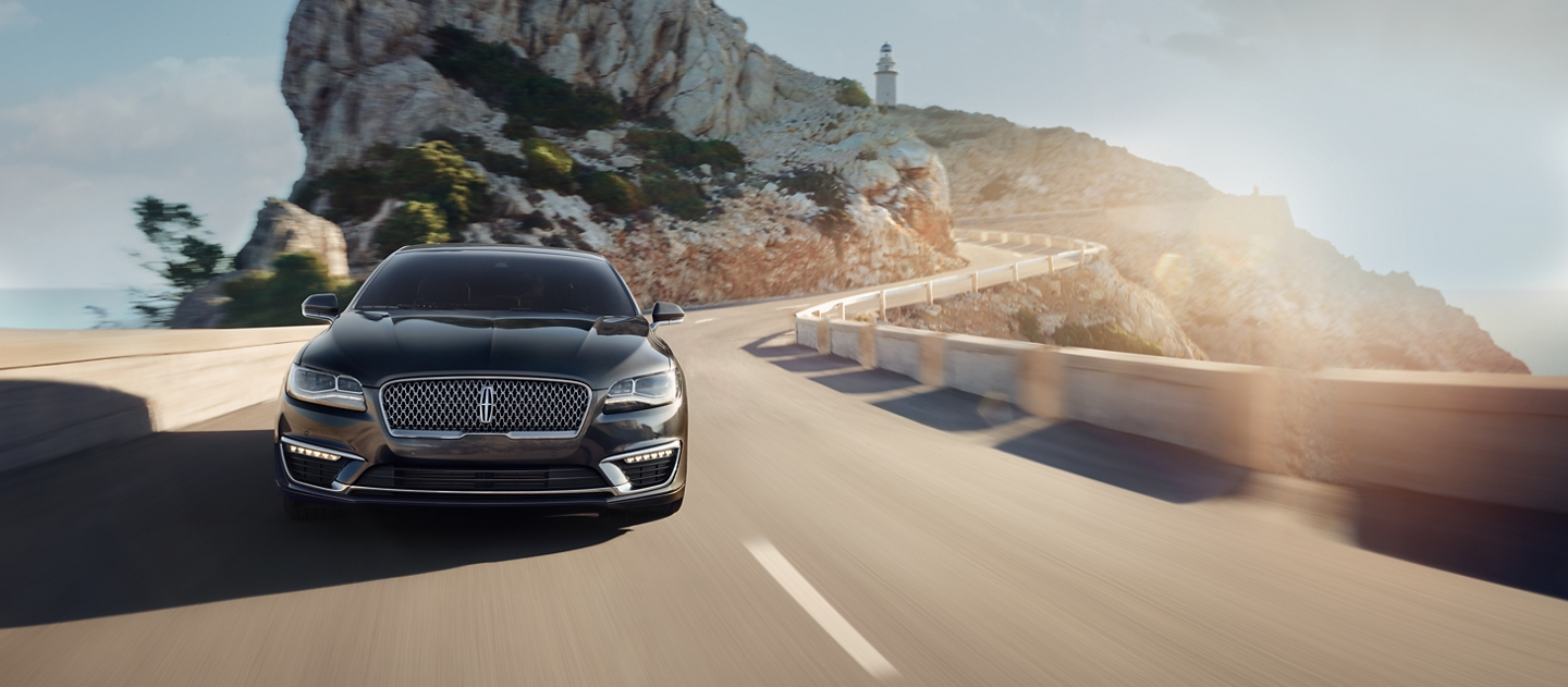 A 2020 Lincoln M K Z is shown being driven along the winding mountain roads of Spain