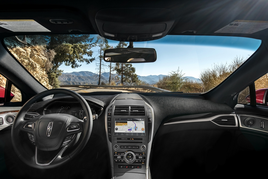 A mountain scene is shown through the windshield of a 2020 Lincoln M K Z as it is parked at a scenic overlook