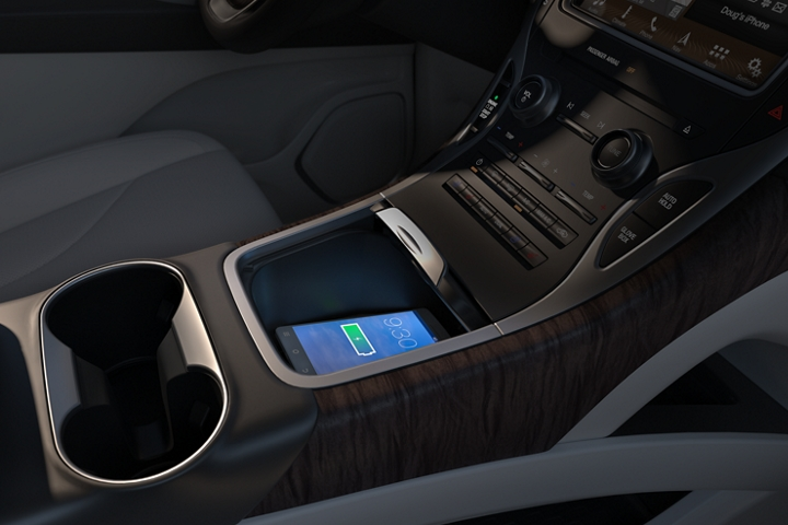 A smart phone is shown charging on the wireless charger in the 2020 Lincoln Nautilus