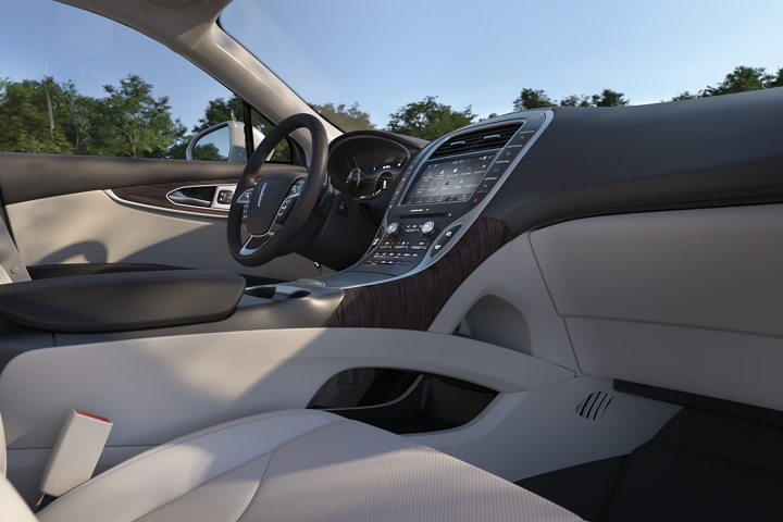 The center stack of the 2020 Lincoln Nautilus is shown which features a pass through for convenient storage