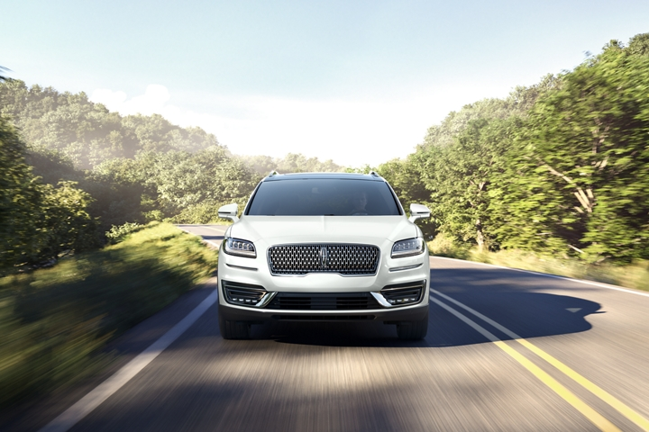 A 2020 Lincoln Nautilus is shown head on to show off the L E D headlamps