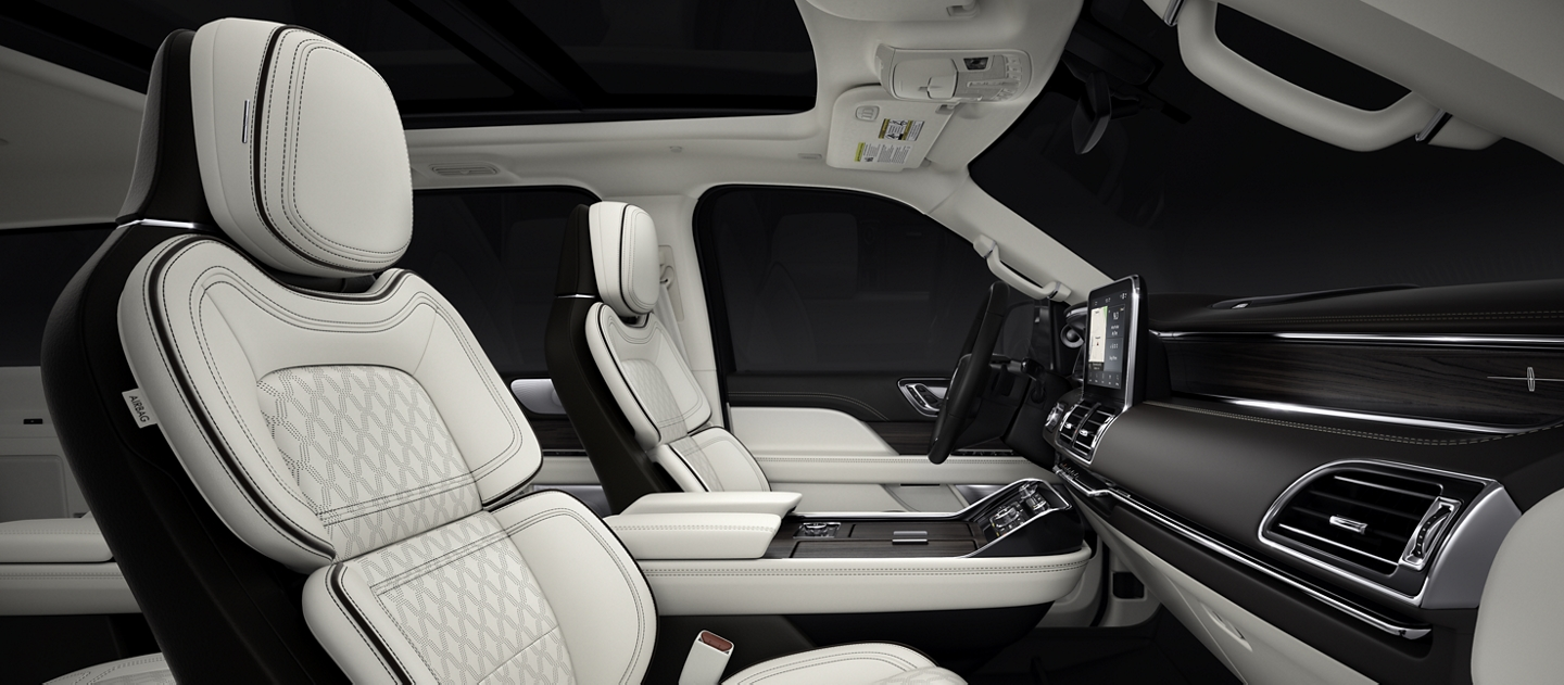 The profile image shows the front seats of a 2020 Lincoln Black Label Navigator in the clean Chalet interior theme