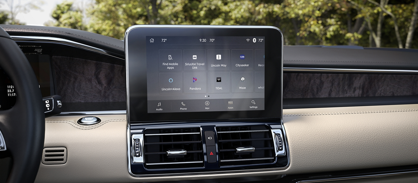 The sleek digital center screen of a 2020 Lincoln Navigator displays different applications and hotspot plus signs that lead to more detailed content