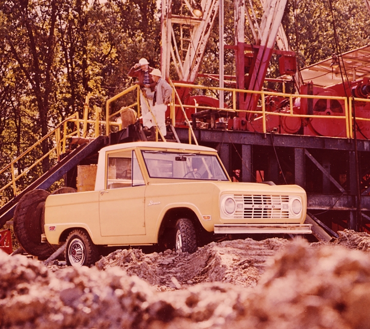 a classic ford bronco is shown parked in a construction site