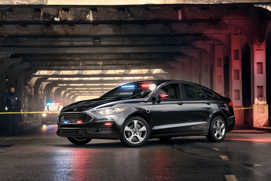 The ford special service plug in hybrid sedan on the site of a crime scene