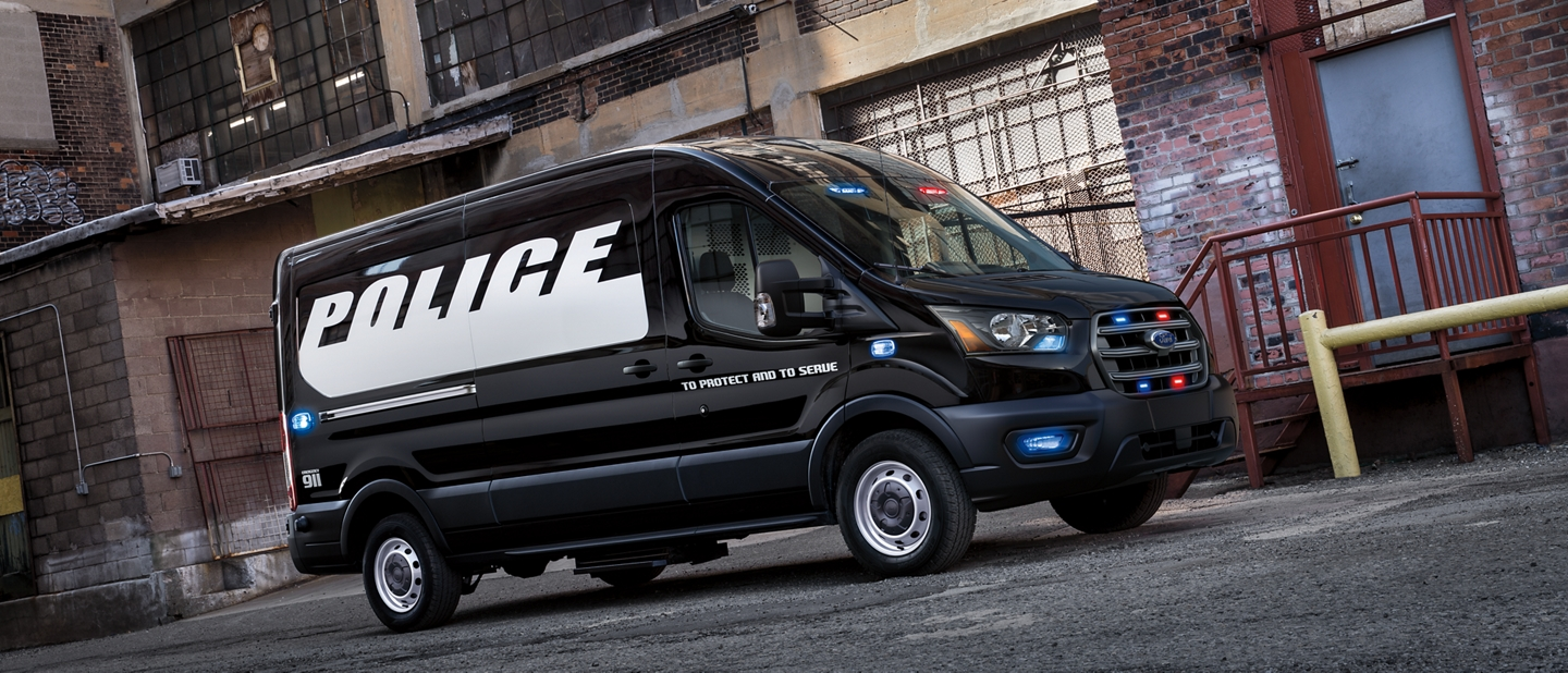 The ford transit prisoner transport vehicle parked in an alley