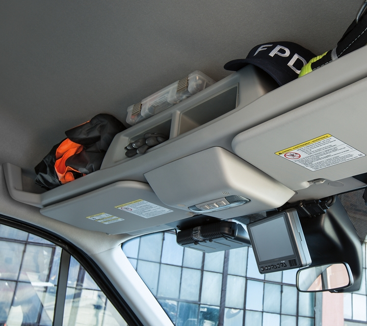 Overhead storage compartments in the twenty twenty ford transit prisoner transport vehicle
