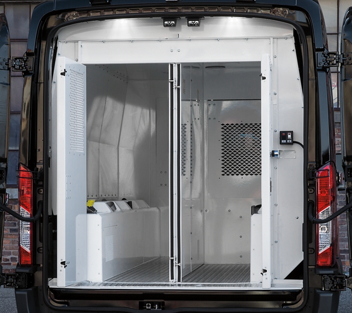 Open rear prisoner compartments in a ford transit prisoner transport vehicle