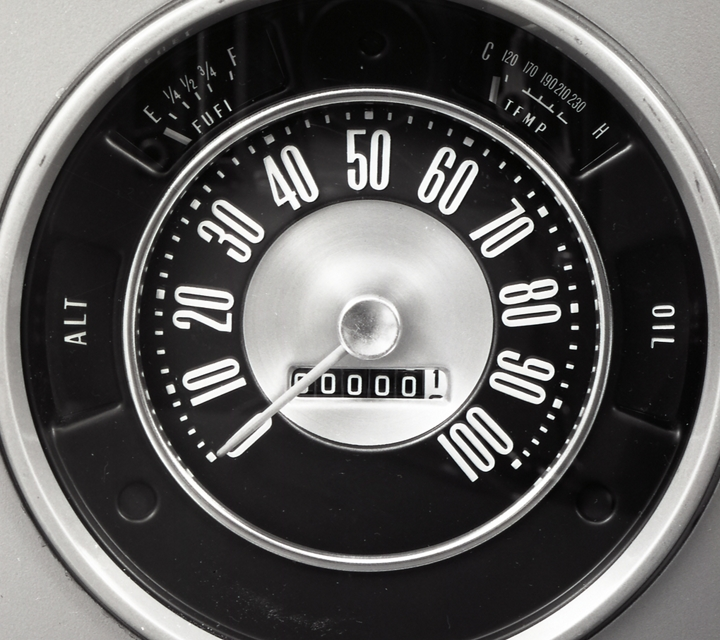 Close up of vintage Ford Bronco speedometer an odometer indicating zero miles