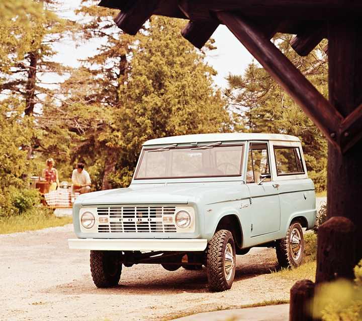 1968 Ford Bronco Sport Wagon in Sky View Blue parked in a suburb