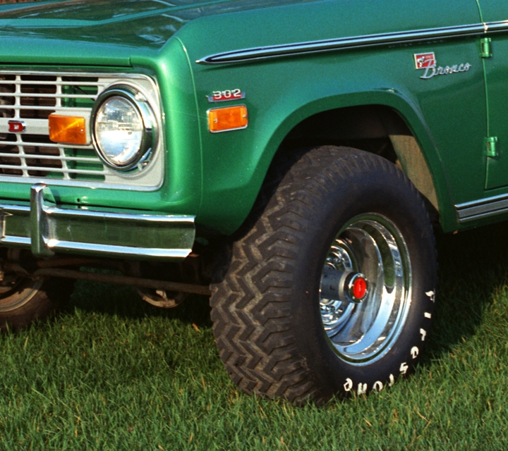 A 1971 Ford Bronco Bronco Sport Wagon with 302 cu. in. V8 and in Mallard Green with Wimbledon White roof parked on grass