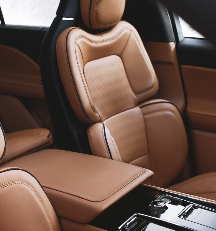 The front row perfect position seats are shown in a rich and warm tan like color