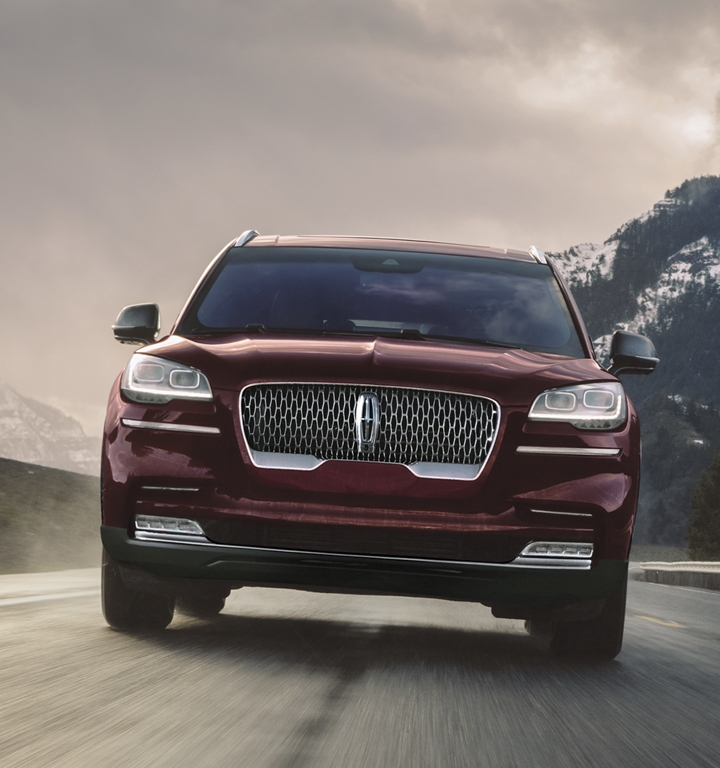 Driver charging a Lincoln Aviator