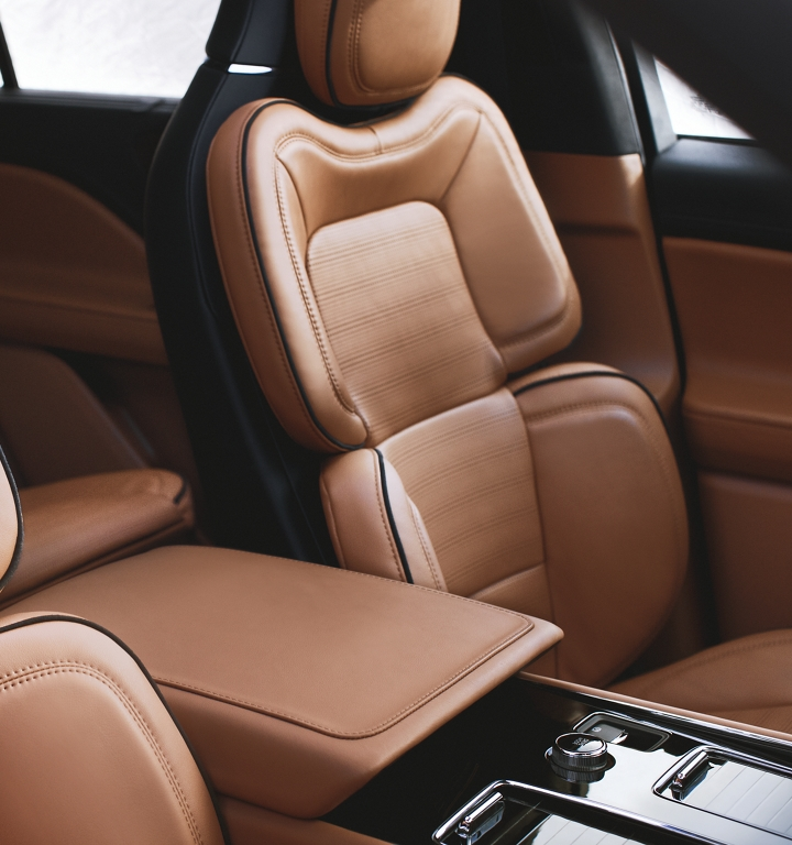 The front row perfect position seats are shown in a rich and warm saturated cognac like interior color