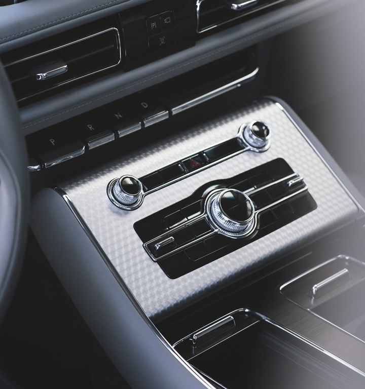 The front center console is shown with chrome like detail and engine turned aluminum applique