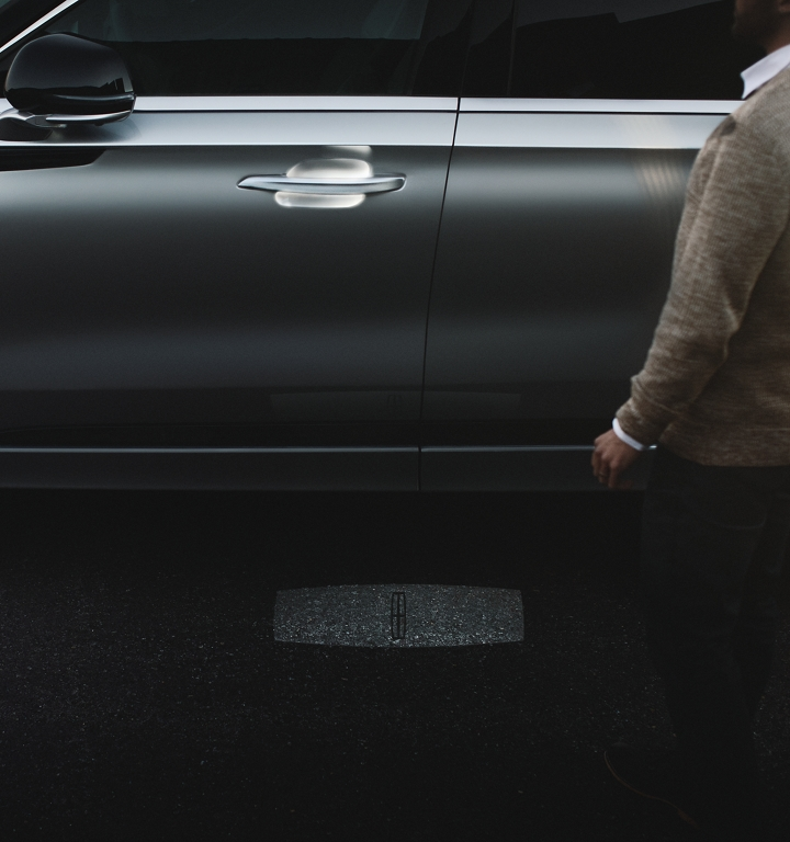A person approaches a Lincoln Aviator as the Lincoln embrace welcome lighting sequence illuminates.